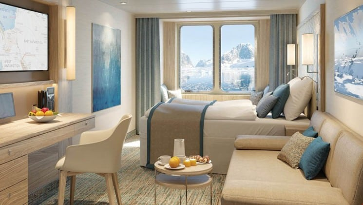 Rendering of Window Suite with bed, couch, desk, chair and large window aboard National Geographic Endurance & Resolution polar expedition ships