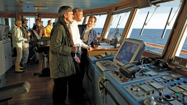 Passengers talk with crew in the bridge of National Geographic Explorer polar expedition ship