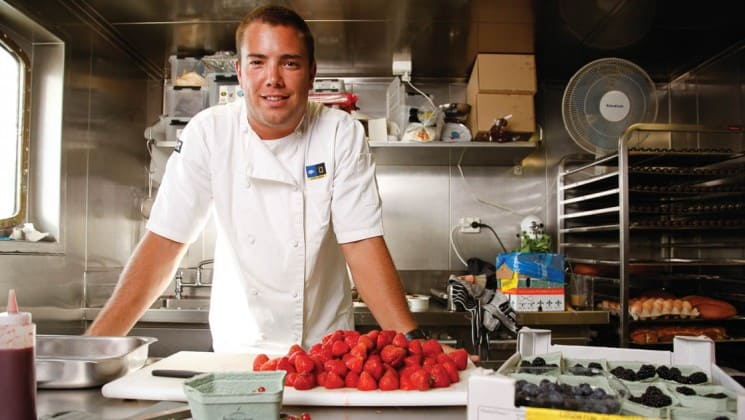 Chef with fresh fruit in the kitchen aboard National Geographic Explorer polar expedition ship