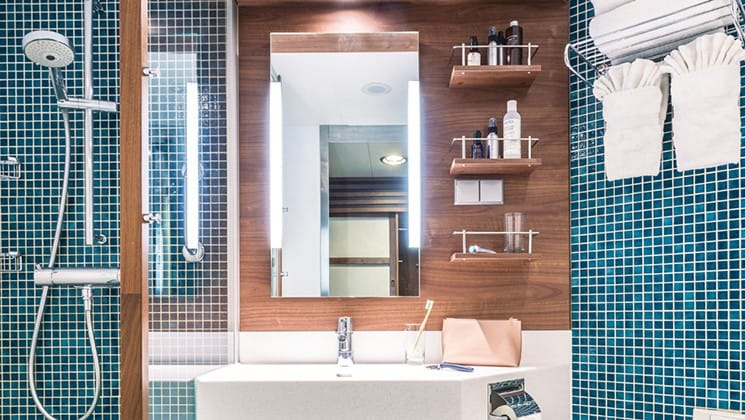Shower, sink and mirror in standard bathroom aboard National Geographic Explorer polar expedition ship