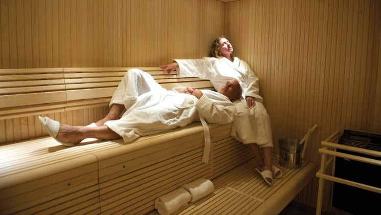 Man and woman in bathrooms relaxing in steam room aboard National Geographic Explorer polar expedition ship
