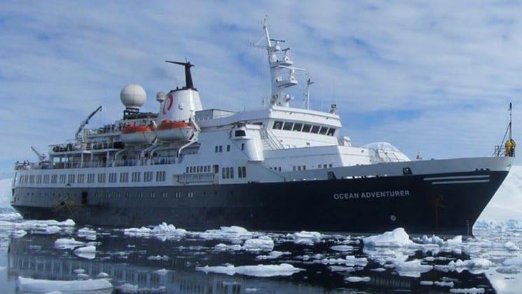 Ocean Adventurer ship exterior picture of starboard side of ship while sailing through small ice bergs.