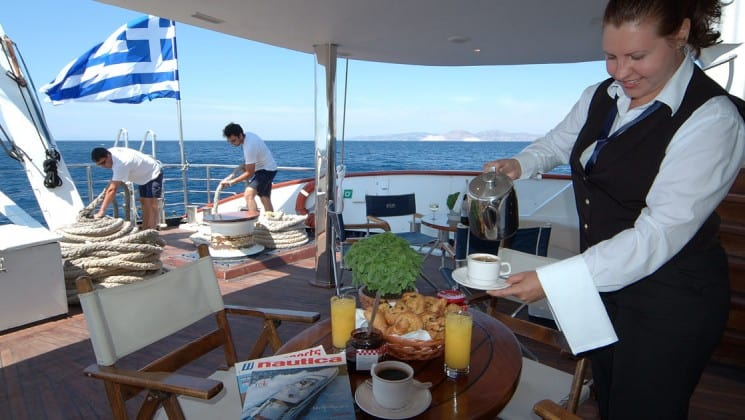 dek of the Panorama Mediterranean luxury yacht with a crew member working in the foreground