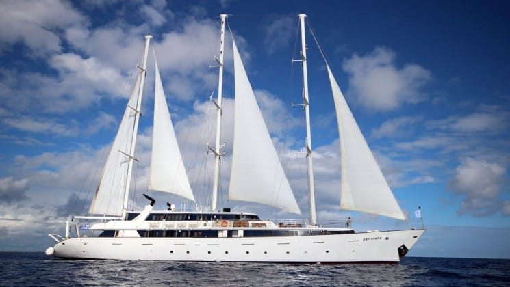 panorama Mediterranean luxury yacht in full sail on a sunny day