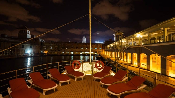 sundeck at night with rows of lounge chairs aboard the Panorama Mediterranean yacht