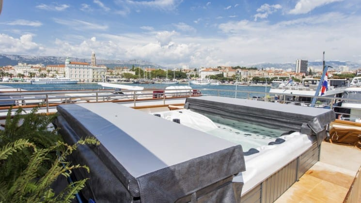 Riva Croatia small ship sun deck with jacuzzi and mediterranean in the background