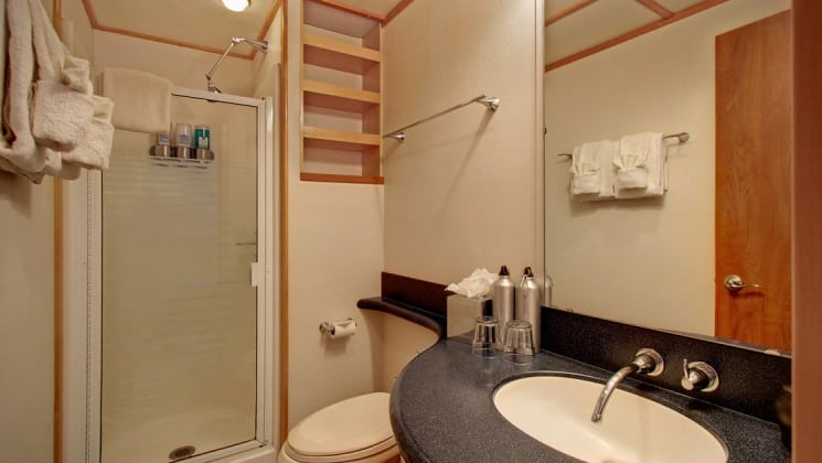 captain stateroom bathroom with vanity, toilet and shower aboard the Safari Quest san juan islands small ship