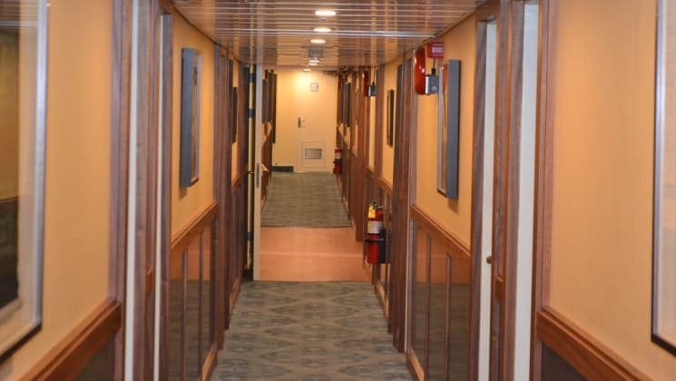 hallway with a light at the end aboard the Safari Voyager Panama small ship