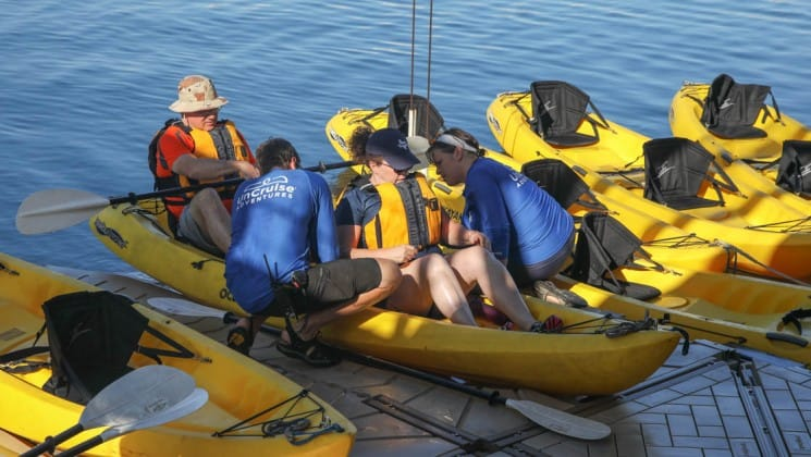 crew helping adventure travelers into kayaks on the back of the Safari Voyager Costa Rica small ship