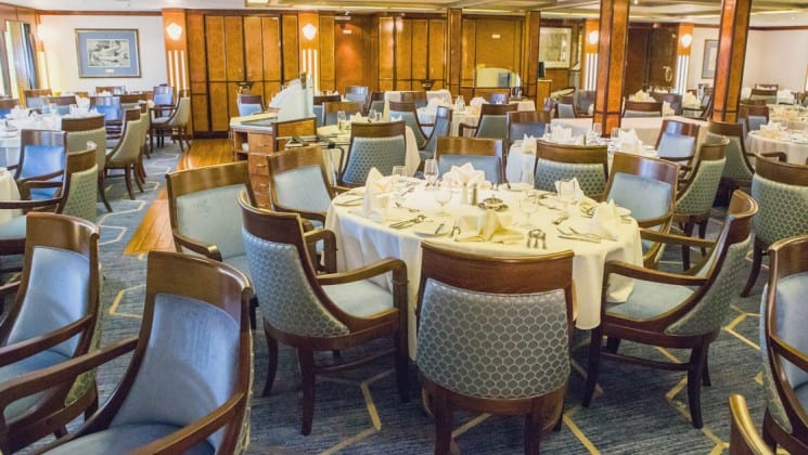 Elegant table settings in dining room aboard Sea Spirit expedition ship