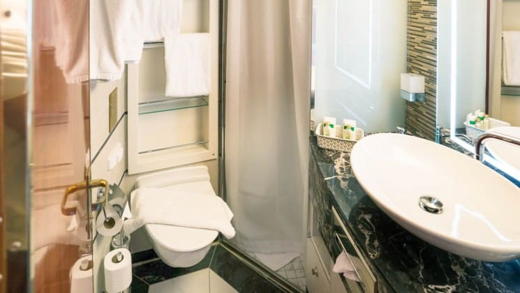 Triple Suite bathroom with toilet, shower and sink aboard Sea Spirit expedition ship