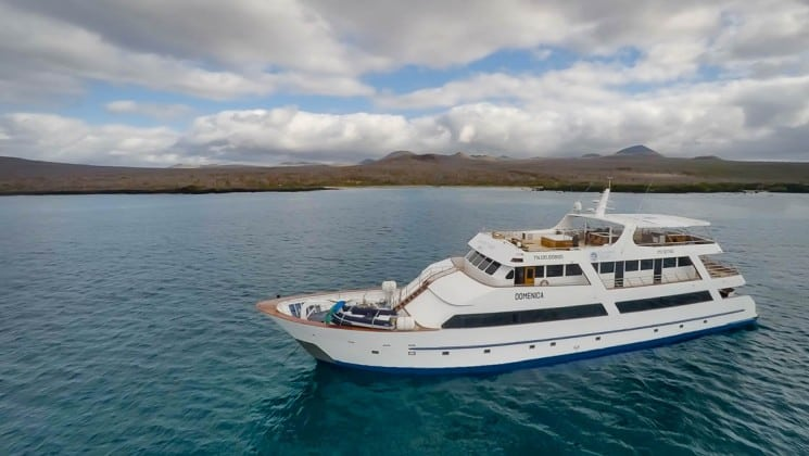 Aerial of port side and bow of Sea Star Journey luxury yacht in the Galapagos Islands