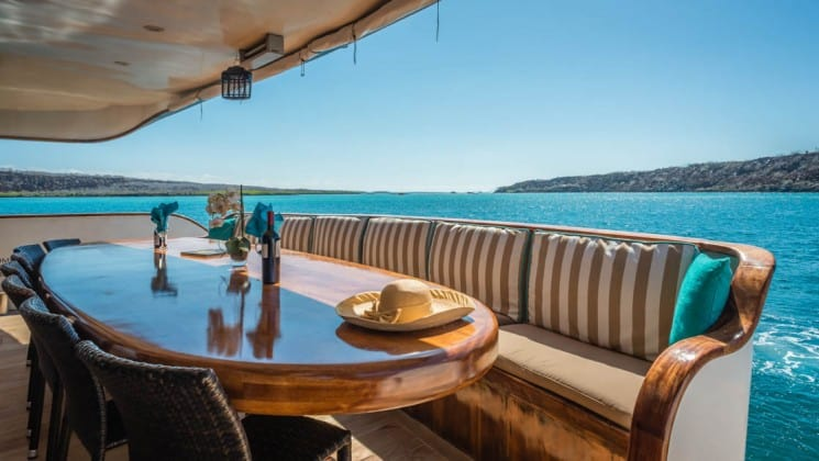 Large outdoor dining table for several guests aboard Sea Star Journey luxury yacht in Galapagos Islands