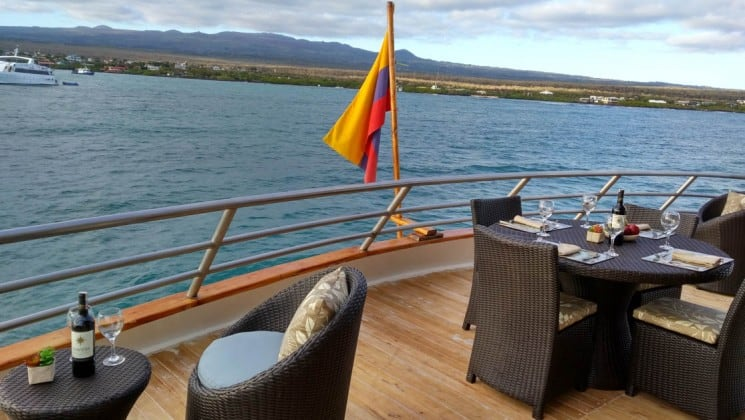Tables and chairs set up on the Upper Deck of Sea Star Journey luxury yacht in the Galapagos Islands