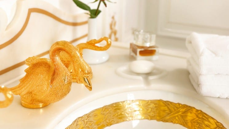 a golden swan faucet and gold lined sink aboard the Lindblad Sea Cloud mediterranean luxury yacht