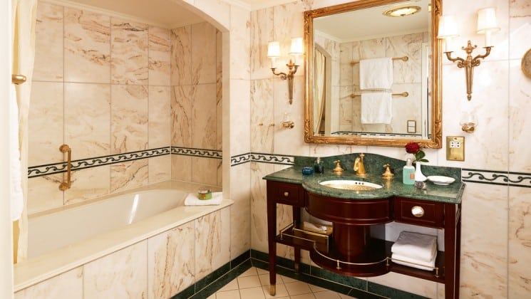 bathroom with marble everywhere, vanity and large mirror aboard the Lindblad Sea Cloud luxury mediterranean small ship