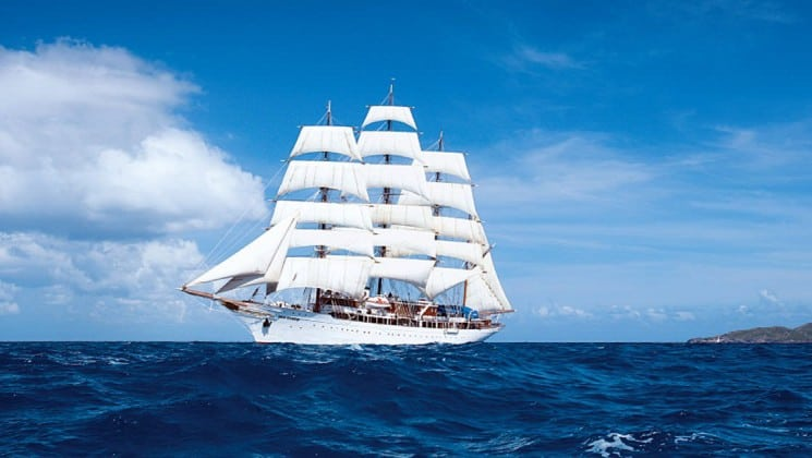 Sea Cloud luxury sailboat cruising in the Mediterranean on a sunny day