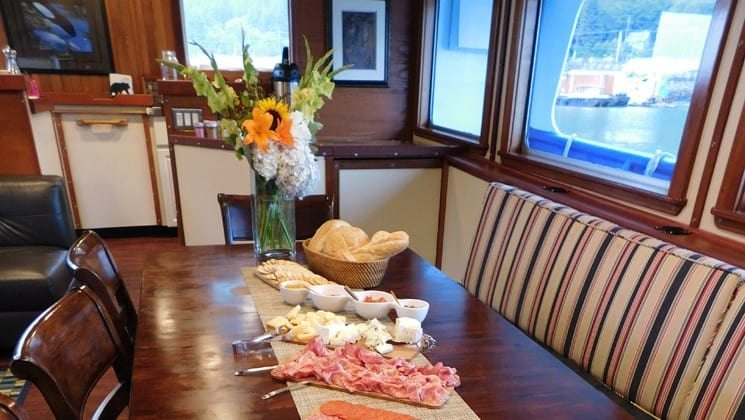 Hors d'ouvres set up on table in dining room aboard Sikumi small ship Alaska cruise