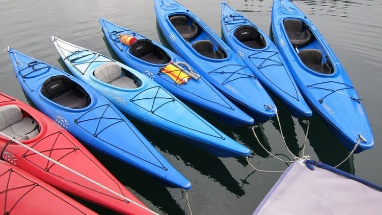Fleet of eight kayaks for guests of Sikumi yacht in Alaska
