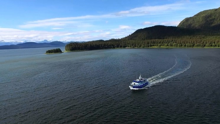 Distant aerial of Sikumi yacht cruising Alaska waters