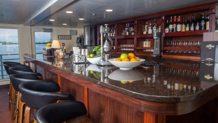 bar with barstools and windows in the background aboard the Safari Voyager Costa Rica small ship