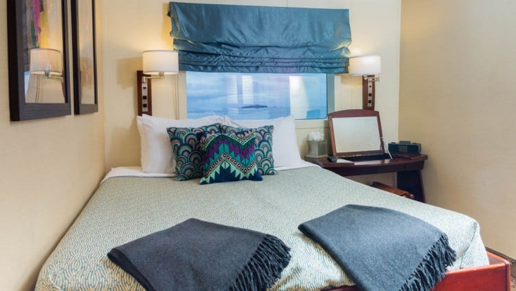 Safari Voyager Commander Stateroom with queen bed
