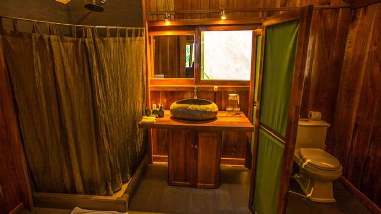 Bathroom with shower, sink, mirror and toilet in tent cabin at Galapagos Safari Camp Santa Cruz Highlands in the Galapagos Islands