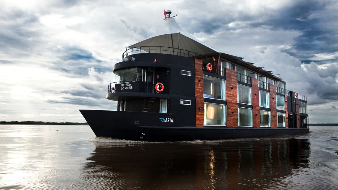 Portside of small ship Aria cruising in the Amazon.