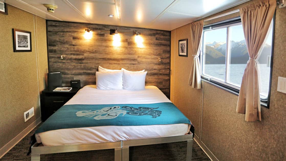 Category AAA Stateroom with double bed and large window aboard Admiralty Dream
