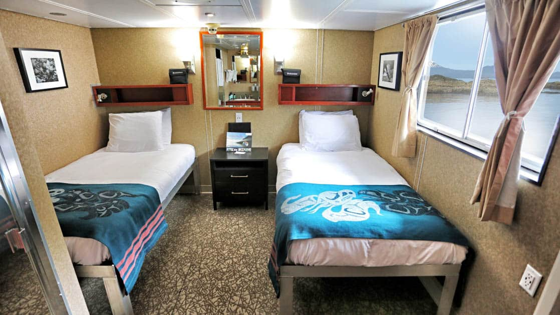 Category AAA stateroom with two twin beds and large window aboard Admiralty Dream