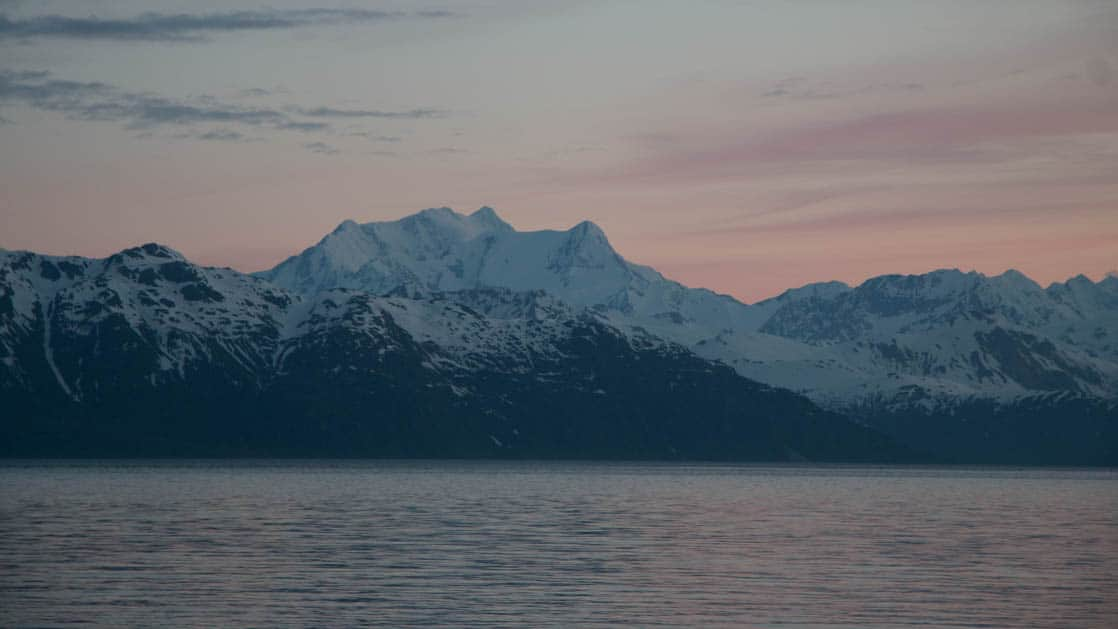 a beautiful sunset over the mountains seen on the alaska's glacier country small ship cruise