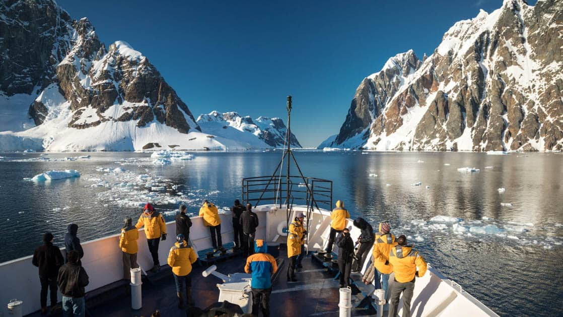 Bow of ship through Lemaire Channel on a sunny Antarctica day