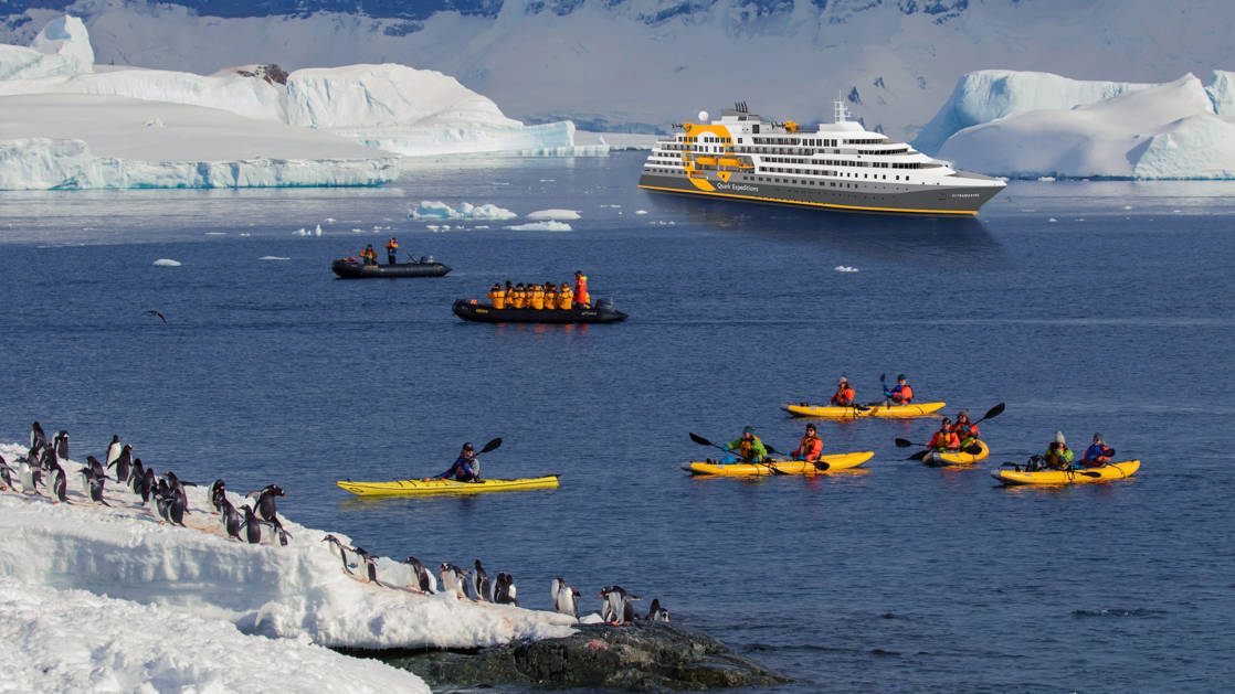 Renderings of kayakers and Zodiac cruisers in Antarctica beside snow-covered shores dotted with penguins with the Ultramarine polar ship in the background.