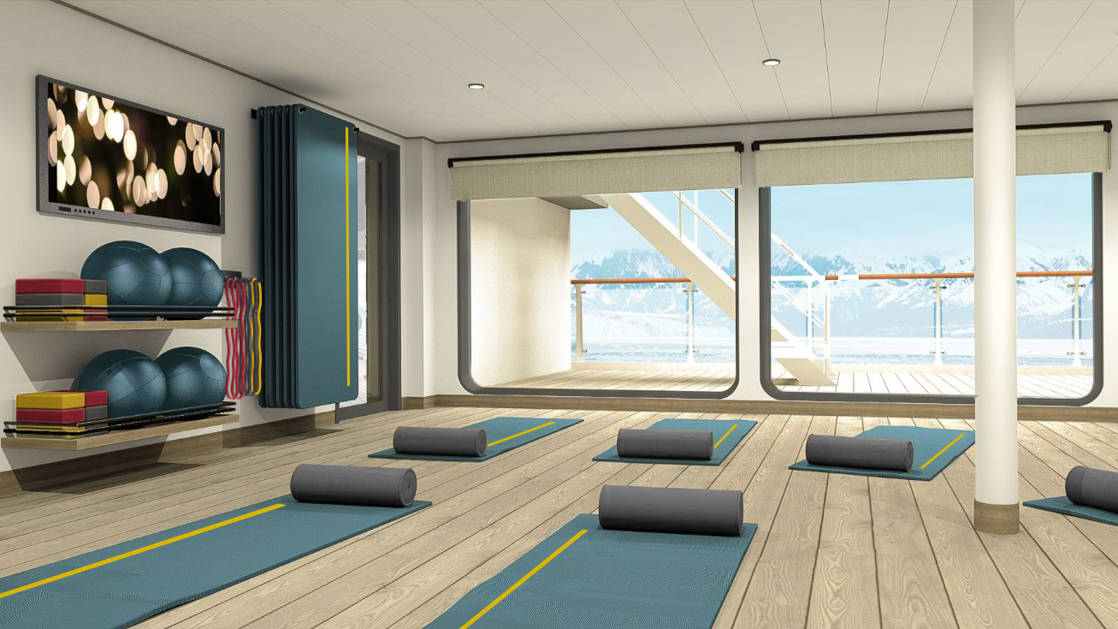 Yoga room with mats laid out on wooden floor aboard Ultramarine expedition ship.