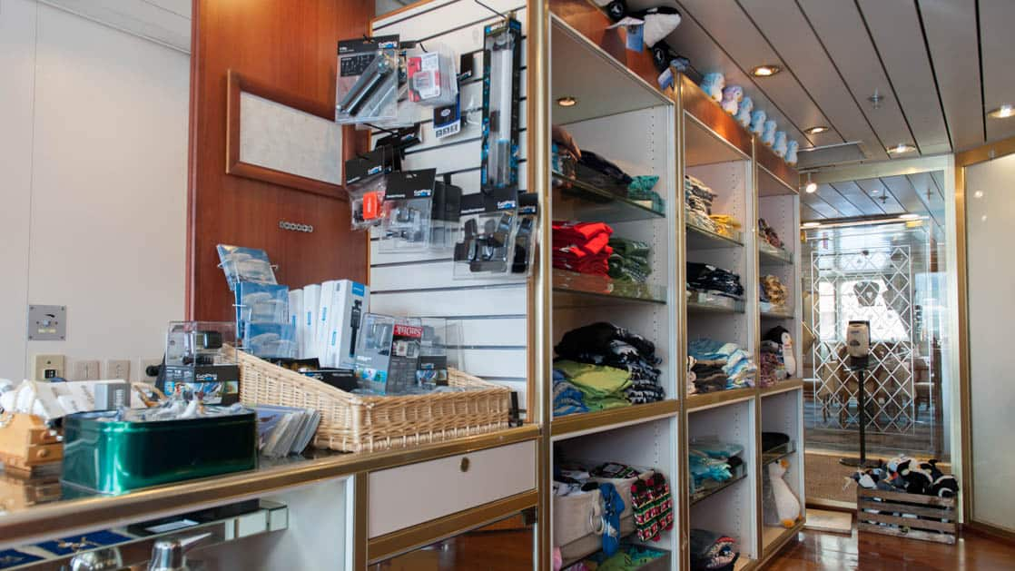 Polar boutique aboard polar ship Ocean Diamond, with shelves lined with clothing, stuffed animals and expedition essentials.