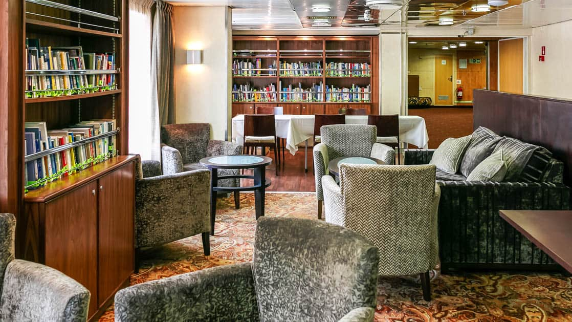 library with plush chairs and couch aboard the Ocean Endeavour small ship
