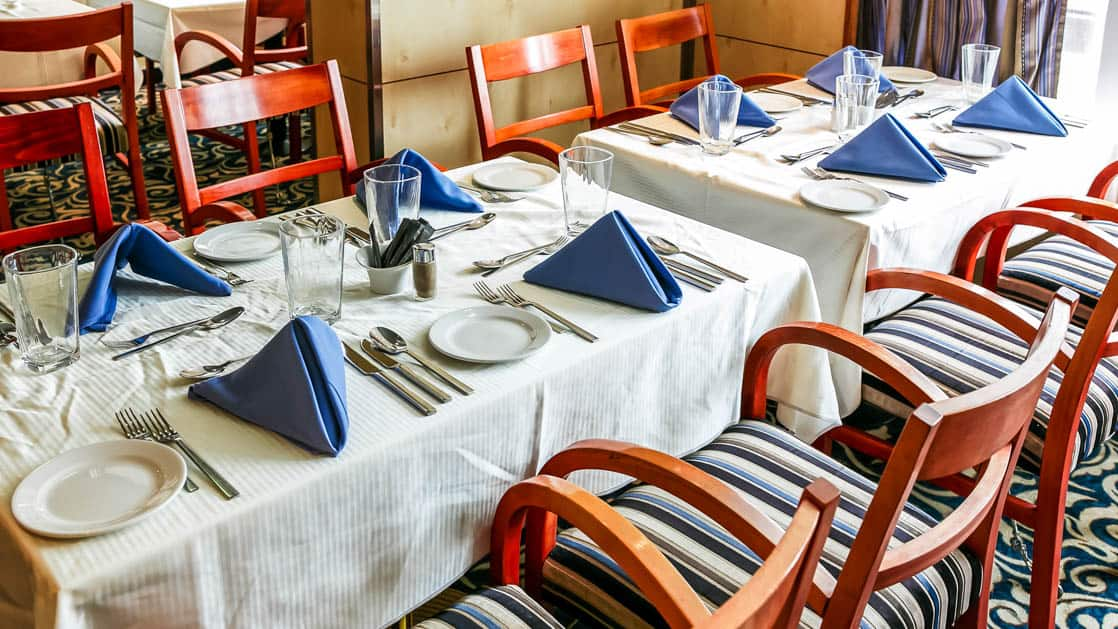 table with linens and silverware aboard the Ocean Endeavour small ship