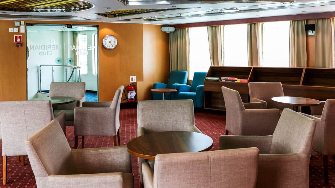 common area with comfortable chairs aboard Ocean Endeavour ship