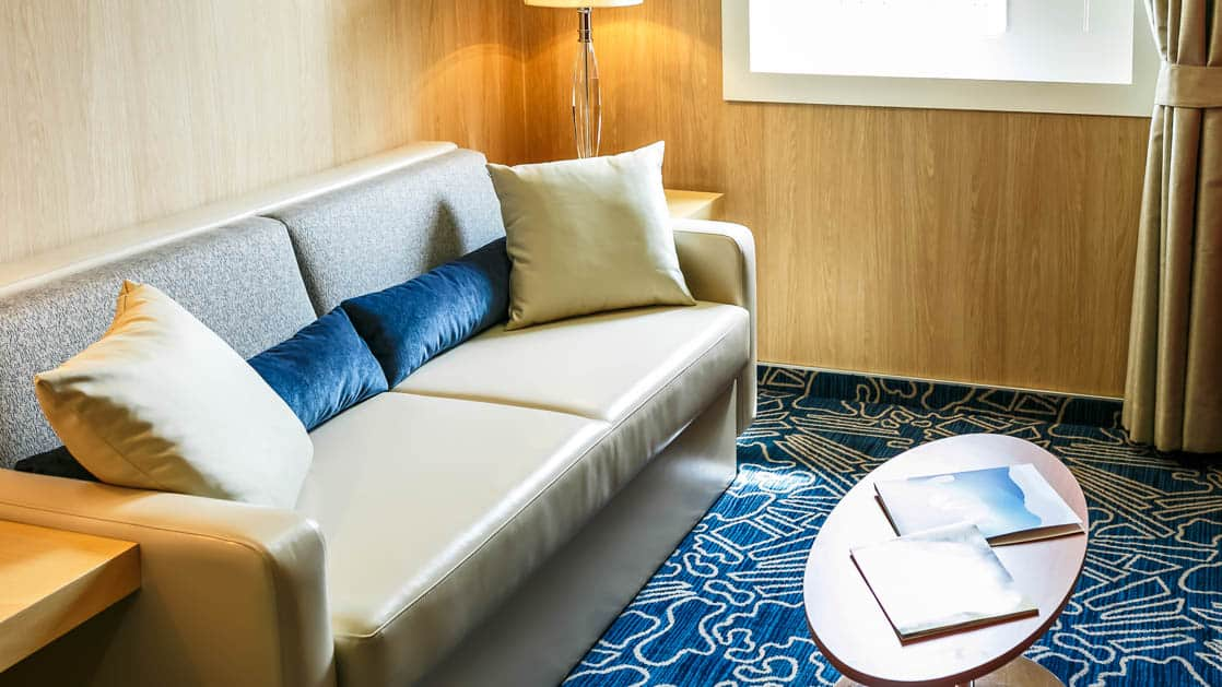 cabin aboard Ocean Endeavour with a couch and table