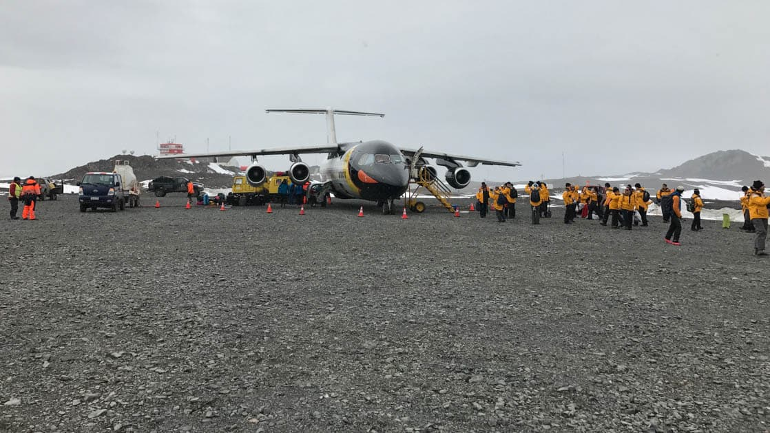 View of plane and passengers on Antarctica runway