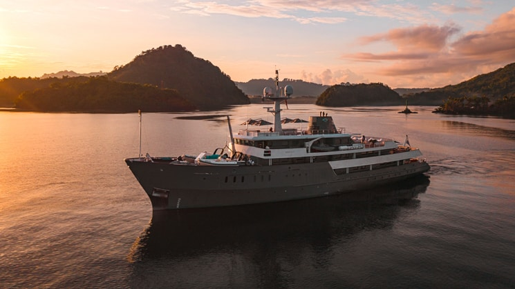 A bring orange and pink sunset as Indonesia yacht Aqua Blu sails