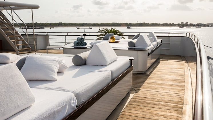 two day beds located outside on the bridge deck with views of ocean in Indonesia aboard aqua blu