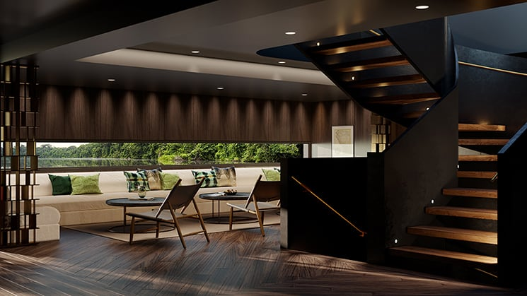Lobby of Aqua Nera Peru Amazon luxury riverboat, with a wraparound white couch and windows, wooden staircase and flooring, and earthtone accents.
