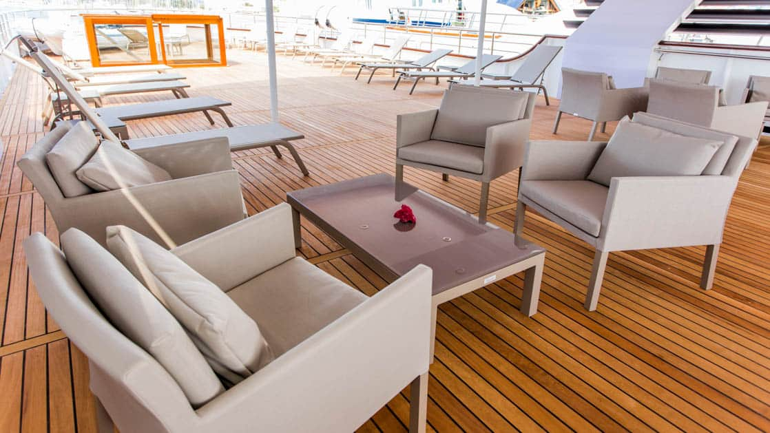 Seating area with chairs and table aboard Avangard.