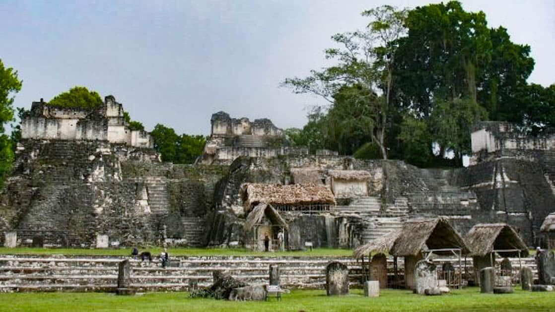 Mayan ruins in tikal guatemala surrounded by lush green