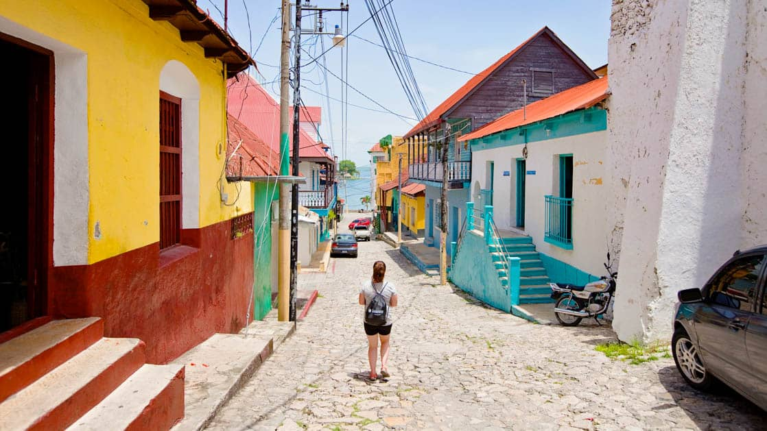 A female walks down an empty street on the Island of Flores in Guatelmala