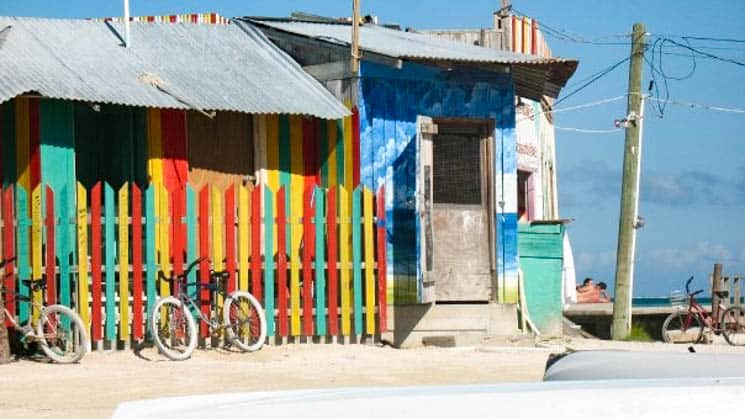 Colorful caribbean beach house with a fence in Belize