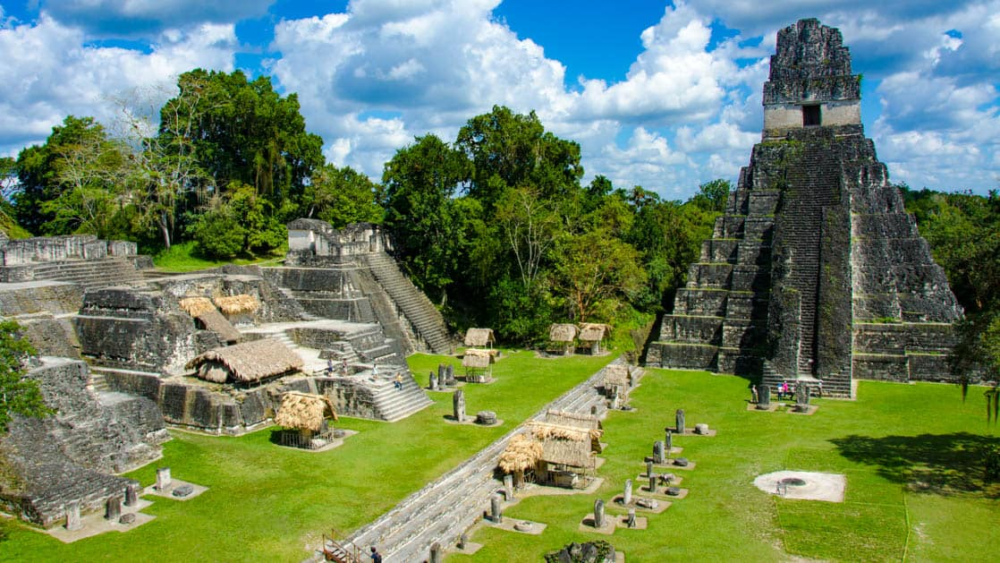 View from one of the temples looking down at a plaza in Tikal Guatemala