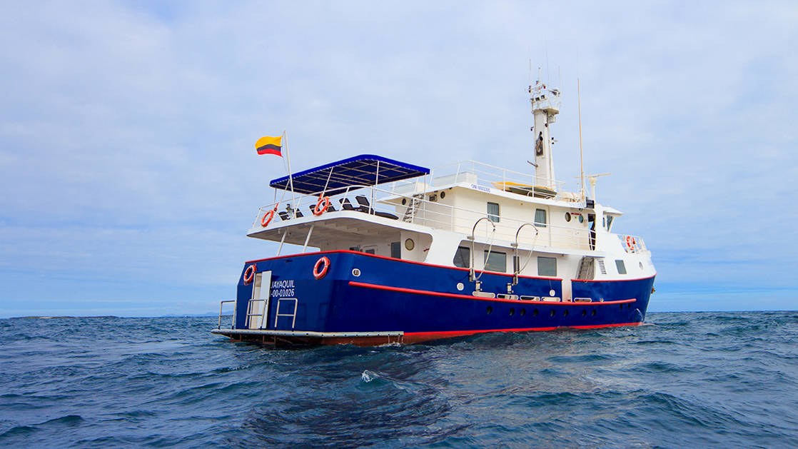 Stern of Cachalote Explorer cruising in the Galapagos.