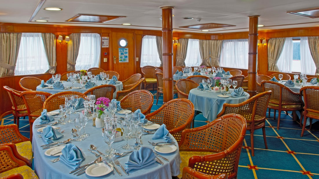 Dining room with tables set aboard Callisto.